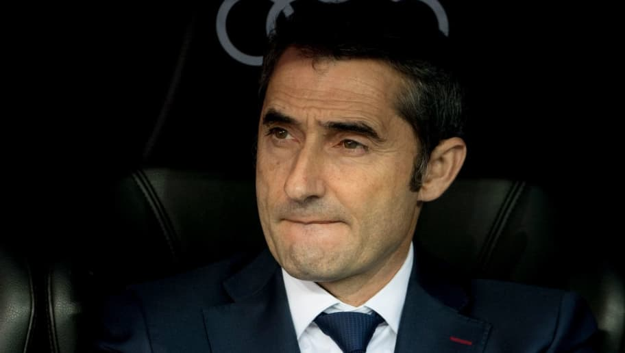 Barcelona's Spanish coach Ernesto Valverde looks on during the Spanish League 'Clasico' football match Real Madrid CF vs FC Barcelona at the Santiago Bernabeu stadium in Madrid on December 23, 2017.  / AFP PHOTO / CURTO DE LA TORRE        (Photo credit should read CURTO DE LA TORRE/AFP/Getty Images)