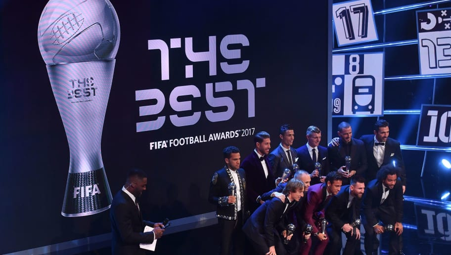 (Back Row L-R), Paris Saint-Germain and Brazil defender Dani Alves, Real Madrid and Spain defender Sergio Ramos, Real Madrid and Portugal forward Cristiano Ronaldo, Real Madrid and Germany midfielder Toni Kroos, AC Milan and Italy defender Leonardo Bonucci, Juventus and Italy goalkeeper Gianluigi Buffon, (front row L-R) Real Madrid and Croatia's midfielder Luca Modric, Barcelona and Spain midfielder Andrés Iniesta, Paris Saint-Germain and Brazil forward Neymar, Barcelona and Argentina forward Lionel Messi and Brazil's defender Marcelo, members of the team winning the FIFA FIFPro World11 award 2017, pose for a group photograph during The Best FIFA Football Awards ceremony, on October 23, 2017 in London. / AFP PHOTO / Ben STANSALL        (Photo credit should read BEN STANSALL/AFP/Getty Images)