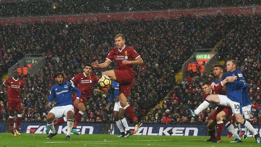 9e0a64352b8 TOPSHOT - Liverpool's Estonian defender Ragnar Klavan (C) jumps to defend a  corner during