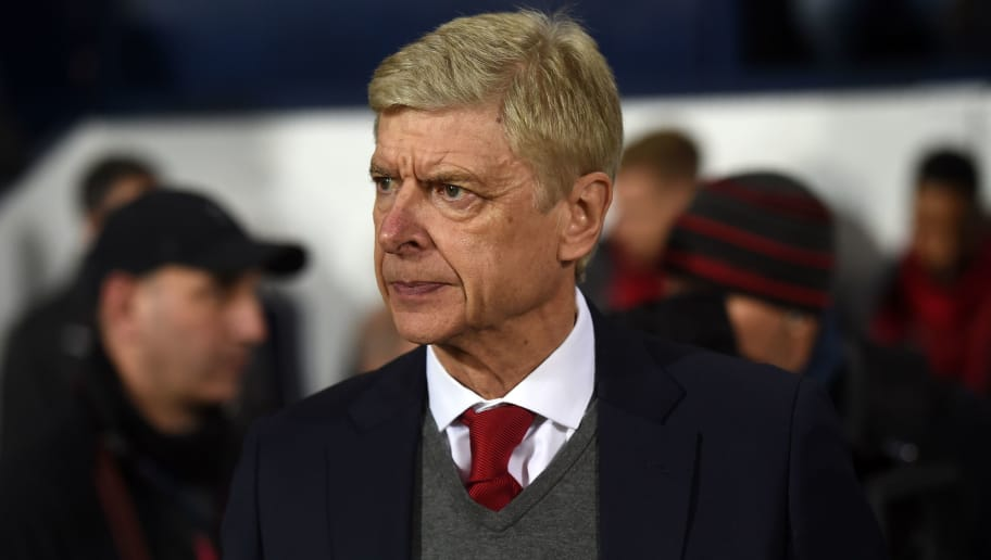 Arsenal's French manager Arsene Wenger awaits kick off in the English Premier League football match between West Bromwich Albion and Arsenal at The Hawthorns stadium in West Bromwich, central England, on December 31, 2017.  / AFP PHOTO / PAUL ELLIS / RESTRICTED TO EDITORIAL USE. No use with unauthorized audio, video, data, fixture lists, club/league logos or 'live' services. Online in-match use limited to 75 images, no video emulation. No use in betting, games or single club/league/player publications.  /         (Photo credit should read PAUL ELLIS/AFP/Getty Images)
