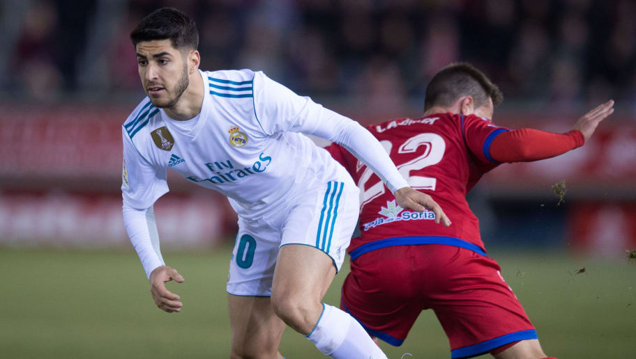 SORIA, SPAIN - JANUARY 04: Marco Asensio of Real Madrid beats Pablo Larrea of Numancia during the Copa del Rey match between Numancia and Real Madrid at Nuevo Estadio Los Pajarito on January 4, 2018 in Soria, Spain. (Photo by Denis Doyle/Getty Images)
