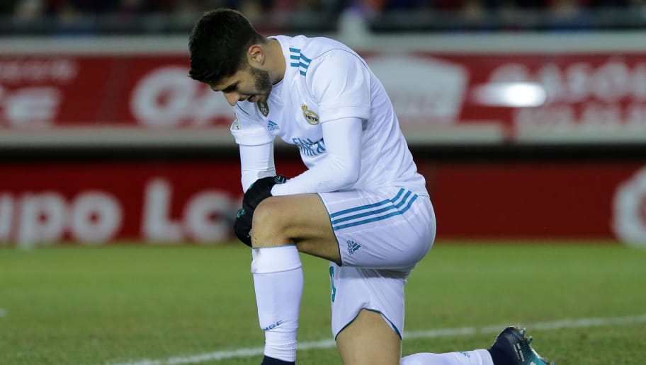 Real Madrid's Spanish midfielder Marco Asensio kneels during the Spanish Copa del Rey (King's Cup) round of 16 first leg football match CD Numancia vs Real Madrid CF at Nuevo Estadio Los Pajaritos stadium in Soria on January 4, 2018. / AFP PHOTO / CESAR MANSO        (Photo credit should read CESAR MANSO/AFP/Getty Images)