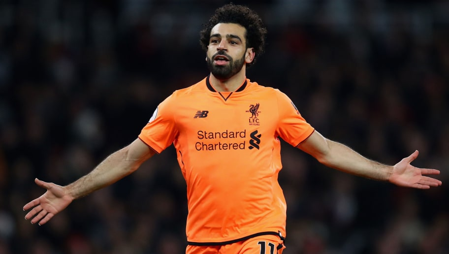 LONDON, ENGLAND - DECEMBER 22:  Mohamed Salah of Liverpool celebrates his teams second goal during the Premier League match between Arsenal and Liverpool at Emirates Stadium on December 22, 2017 in London, England.  (Photo by Julian Finney/Getty Images)