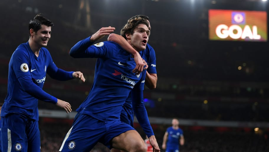 LONDON, ENGLAND - JANUARY 03:  Marcos Alonso of Chelsea celebrates scoring his sides second goal with Danny Drinkwater of Chelsea (obscured) during the Premier League match between Arsenal and Chelsea at Emirates Stadium on January 3, 2018 in London, England.  (Photo by Shaun Botterill/Getty Images)