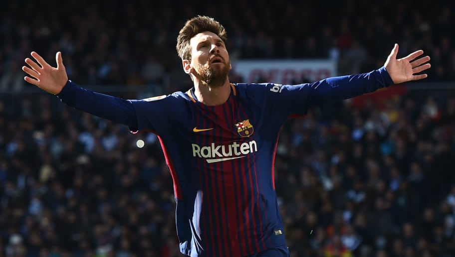 MADRID, SPAIN - DECEMBER 23:  Lionel Messi of Barcelona celebrates after scoring his sides second goal during the La Liga match between Real Madrid and Barcelona at Estadio Santiago Bernabeu on December 23, 2017 in Madrid, Spain.  (Photo by Denis Doyle/Getty Images)