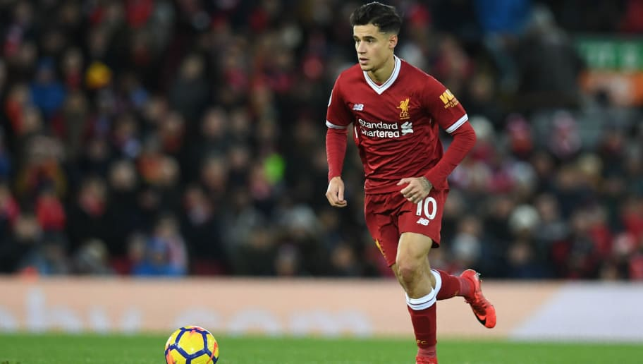 Liverpool's Brazilian midfielder Philippe Coutinho controls the ball during the English Premier League football match between Liverpool and Leicester at Anfield in Liverpool, north west England on December 30, 2017. / AFP PHOTO / Paul ELLIS / RESTRICTED TO EDITORIAL USE. No use with unauthorized audio, video, data, fixture lists, club/league logos or 'live' services. Online in-match use limited to 75 images, no video emulation. No use in betting, games or single club/league/player publications.  /         (Photo credit should read PAUL ELLIS/AFP/Getty Images)