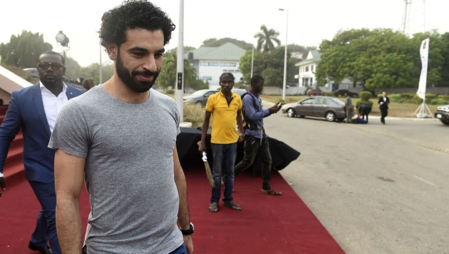Liverpool's Egyptian striker and African Player of the Year Award nominee Mohamed Salah leaves after a media briefing on the Confederation of African Football (CAF) awards ceremony at the International Conference Centre in Accra, on January 4, 2018.  Liverpool star Mohamed Salah hopes to add the African Player of the Year award in Ghana on January 4 to his rapidly expanding collection of individual honours. The Egyptian, scorer of 23 goals in all competitions midway through his first season at Anfield, has been voted BBC African Footballer of the Year and Arab Player of the Year.  / AFP PHOTO / PIUS UTOMI EKPEI        (Photo credit should read PIUS UTOMI EKPEI/AFP/Getty Images)
