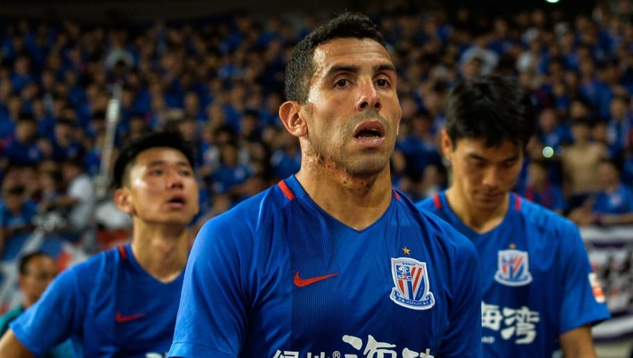 Shanghai Shenhua's Carlos Tevez walks to stands after losing the 2017 Chinese Super League football match between Shanghai East Asia (SIPG) FC and Shanghai Shenhua in Shanghai on September 16, 2017. / AFP PHOTO / CHANDAN KHANNA / China OUT / XGTY        (Photo credit should read CHANDAN KHANNA/AFP/Getty Images)