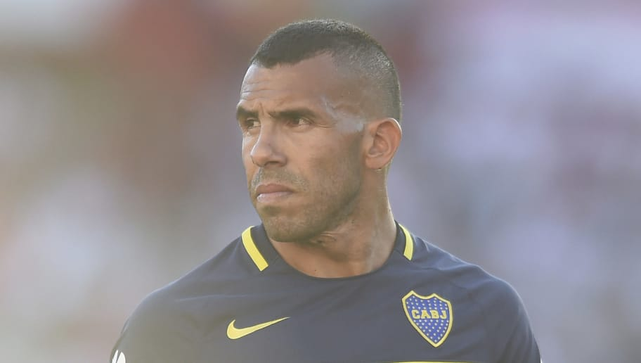 BUENOS AIRES, ARGENTINA - DECEMBER 11: Carlos Tevez of Boca Juniors looks on during a match between River Plate and Boca Juniors as part of Torneo Primera Division 2016/17 at Monumental Stadium on December 11, 2016 in Buenos Aires, Argentina. (Photo by Marcelo Endelli/LatinContent/Getty Images)