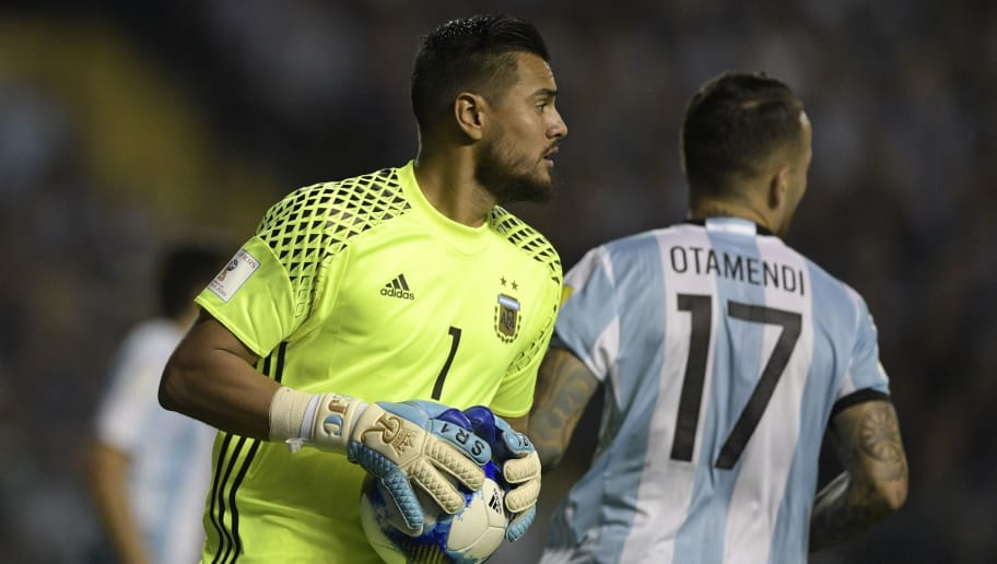 Argentina's goalkeeper Sergio Romero holds the ball during the 2018 World Cup qualifier football match against Peru in Buenos Aires on October 5, 2017. / AFP PHOTO / Juan MABROMATA        (Photo credit should read JUAN MABROMATA/AFP/Getty Images)