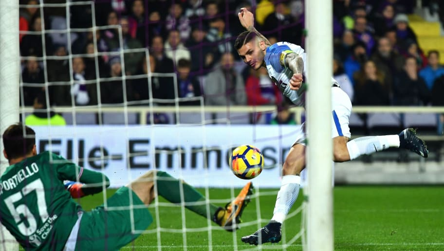 Inter Milan's Argentinian forward Mauro Icardi (R) scores past Fiorentina's goalkeeper Marco Sportiello during the Italian Serie A football match between Fiorentina and Inter Milan at The Artemio Franchi Stadium in Florence on January 5, 2018. / AFP PHOTO / ALBERTO PIZZOLI        (Photo credit should read ALBERTO PIZZOLI/AFP/Getty Images)