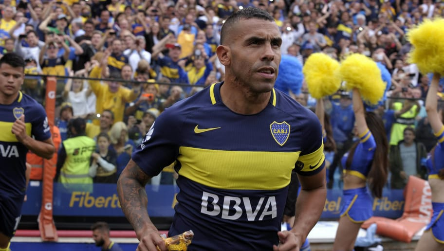 Boca Juniors' forward Carlos Tevez enters the field before their Argentina First Division football match against Colon,  at La Bombonera stadium, in Buenos Aires, on December 18, 2016. / AFP / ALEJANDRO PAGNI        (Photo credit should read ALEJANDRO PAGNI/AFP/Getty Images)