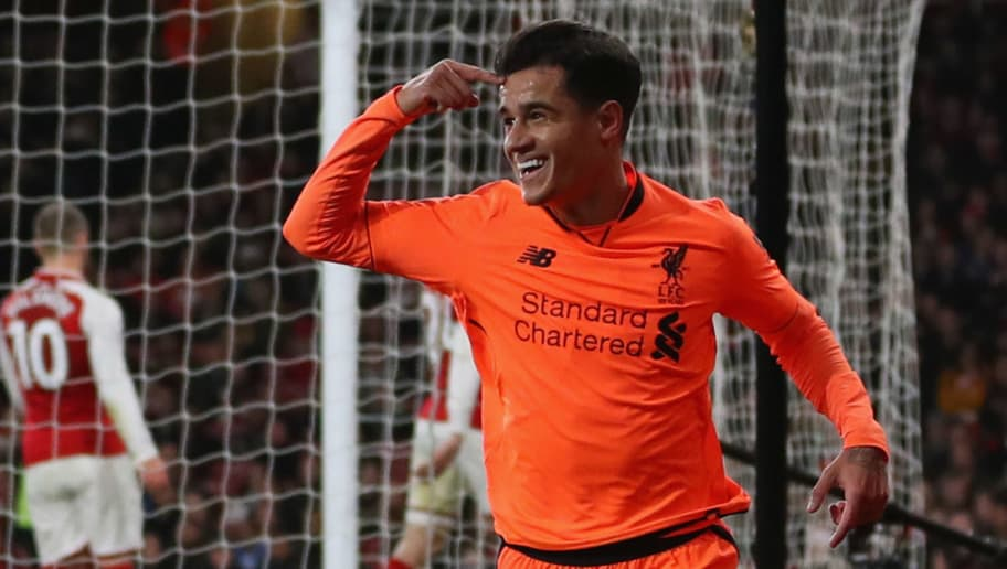 LONDON, ENGLAND - DECEMBER 22:  Philippe Coutinho of Liverpool celebrates as he scores their first goal during the Premier League match between Arsenal and Liverpool at Emirates Stadium on December 22, 2017 in London, England.  (Photo by Catherine Ivill/Getty Images)