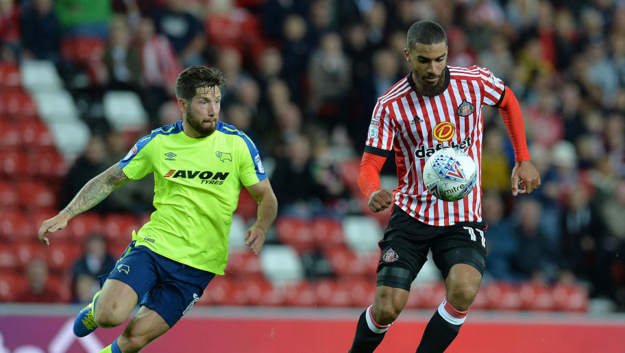 SUNDERLAND, ENGLAND - AUGUST 04: Lewis Grabban (R), of Sunderland takes on Jacob Butterfield of Derby County during the Sky Bet Championship match between Sunderland and Derby County at Stadium of Light on August 4, 2017 in Sunderland, England. (Photo by Mark Runnacles/Getty Images)