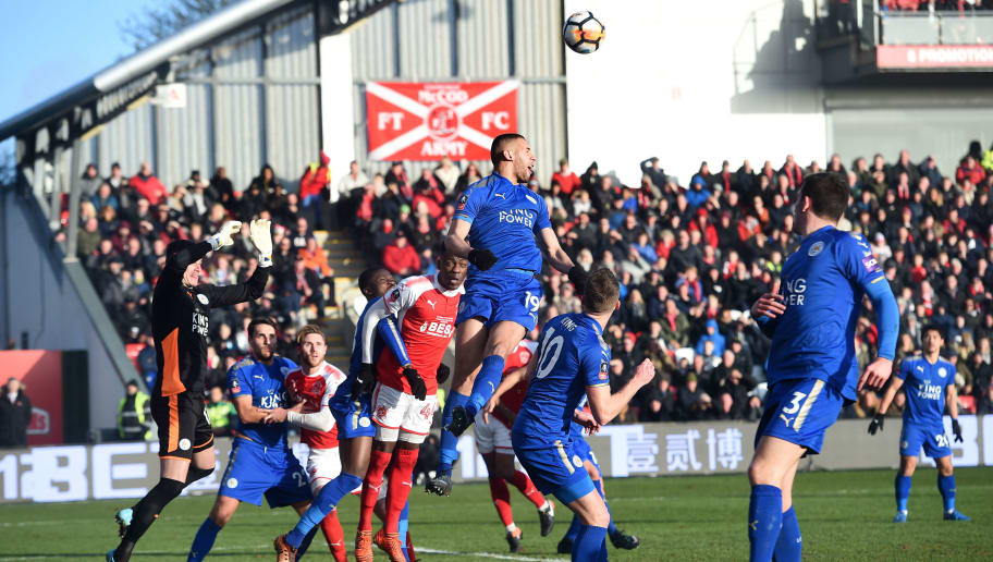 Leicester City's Algerian striker Islam Slimani (C) heads the ball during the English FA Cup third round football match between Fleetwood Town and Leicester City at Highbury Stadium in Fleetwood, north west England on January 6, 2018. / AFP PHOTO / PAUL ELLIS / RESTRICTED TO EDITORIAL USE. No use with unauthorized audio, video, data, fixture lists, club/league logos or 'live' services. Online in-match use limited to 75 images, no video emulation. No use in betting, games or single club/league/player publications.  /         (Photo credit should read PAUL ELLIS/AFP/Getty Images)