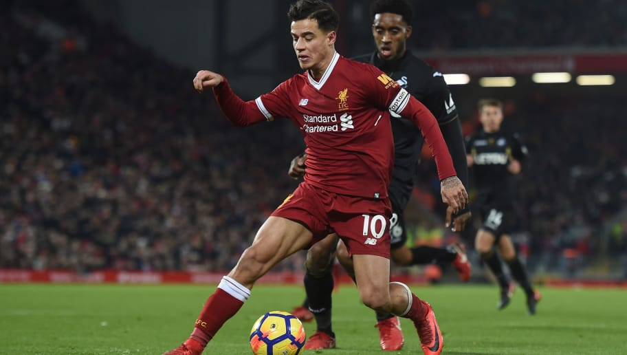 Liverpool's Brazilian midfielder Philippe Coutinho (L) takes on Swansea City's Dutch midfielder Leroy Fer (R) during the English Premier League football match between Liverpool and Swansea City at Anfield in Liverpool, north west England on December 26, 2017. / AFP PHOTO / PAUL ELLIS / RESTRICTED TO EDITORIAL USE. No use with unauthorized audio, video, data, fixture lists, club/league logos or 'live' services. Online in-match use limited to 75 images, no video emulation. No use in betting, games or single club/league/player publications.  /         (Photo credit should read PAUL ELLIS/AFP/Getty Images)