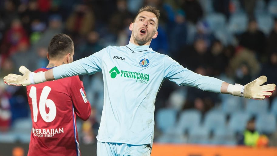 Getafe's goalkeeper Vicente Guaita complains to referee during the Spanish league football match Getafe CF vs Club Atletico de Madrid at the Col. Alfonso Perez stadium in Getafe on February 14, 2016.   / AFP / CURTO DE LA TORRE        (Photo credit should read CURTO DE LA TORRE/AFP/Getty Images)