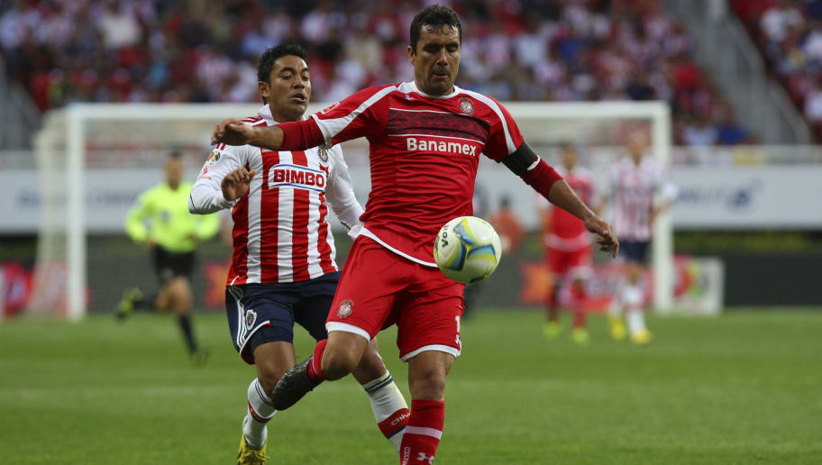 GUADALAJARA, MEXICO - JANUARY 06: Marcos Fabian of Chivas fights for the ball with Edgar Dueñas of Toluca during the match between Chivas and Toluca as part of the Clausura 2013 Liga MX tournament at Omnilife Stadium on January 06, 2013 in Guadalajara, Mexico. (Photo by Cioran  Castañeda/LatinContent/Getty Images)
