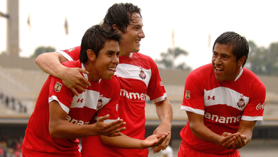 MEXICO CITY - JULY 25: Nestor Calderon (L), Antonio Rios (C) and Manuel Alejandro de la Torre (R) of Toluca celebrate a goal against Pumas during match as part of the 2010 Aperture Tournament in the Mexican Football League at the Olimpico Universitario Stadium on July 25, 2010 in Mexico City, Mexico. (Photo by Hector Vivas/LatinContent/Getty Images)