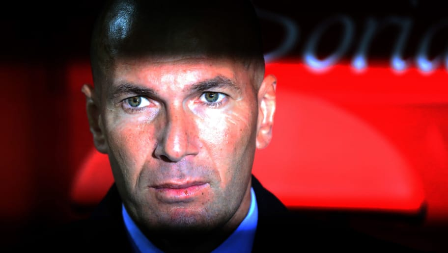Real Madrid's French coach Zinedine Zidane looks on from the bench before the Spanish Copa del Rey (King's Cup) football match CD Numancia vs Real Madrid CF at the 'Nuevo Estadio Los Pajaritos' stadium in Soria on January 4, 2018. / AFP PHOTO / CESAR MANSO        (Photo credit should read CESAR MANSO/AFP/Getty Images)