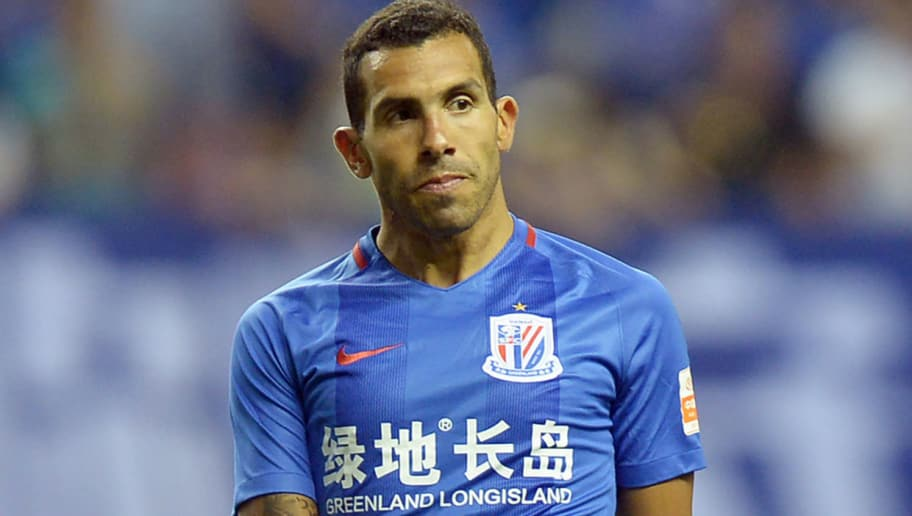 This photo taken on June 17, 2017 shows Argentine striker Carlos Tevez of Shanghai Shenhua reacting in their 13th round match against Chongqing Lifan during the 2017 Chinese Football Association Super League (CSL) in Shanghai. Shenhua shelled out some of the highest wages in football -- reported weekly wages of 730,000 euros -- to lure forward Carlos Tevez to China this season but he has scored just twice and is not expected to feature at the weekend after Poyet's replacement Wu Jingui said the Argentine was overweight. / AFP PHOTO / STR / China OUT        (Photo credit should read STR/AFP/Getty Images)
