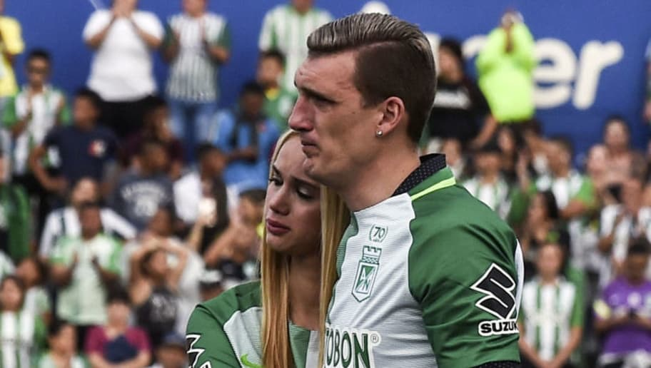 Argentinian goalkeeper Franco Armani and his wife Paola Rendon are pictured during his farewell from Colombia's Atletico Nacional at the Atanasio Girardot Stadium in Medellin, on January 5, 2018.  Armani won 13 titles with Atletico Nacional and will play the next stage of his career in Argentina's River Plate. / AFP PHOTO / JOAQUIN SARMIENTO        (Photo credit should read JOAQUIN SARMIENTO/AFP/Getty Images)