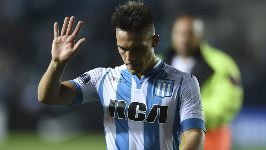 AVELLANEDA, ARGENTINA - NOVEMBER 01: Lautaro Martinez of Racing Club leaves the field as he greets the fans after being disqualified during a second leg match between Racing Club and Libertad as part of the quarter finals of Copa CONMEBOL Sudamericana 2017 at Presidente Peron Stadium on November 01, 2017 in Avellaneda, Argentina. (Photo by Marcelo Endelli/Getty Images)