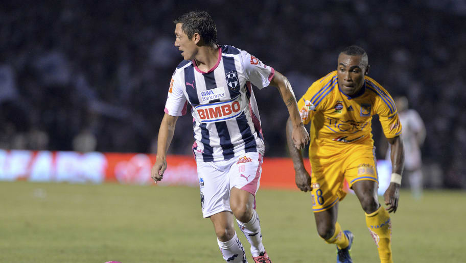 MONTERREY, MEXICO - OCTOBER 25:  Nery Cardozo of Monterrey (L) drives the ball as Joffre Guerron of Tigres (R) follows him during a match between Monterrey and Tigres UANL as part of 14th round Apertura 2014 Liga MX at Tecnologico Stadium on October 25, 2014 in Monterrey, Mexico. (Photo by Ivan Villa/LatinContent/Getty Images)