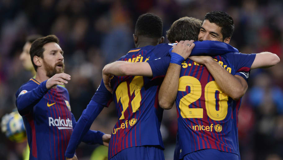 Barcelona's Uruguayan forward Luis Suarez (R) celebrates a goal with teammates during the Spanish league football match FC Barcelona vs Levante UD at the Camp Nou stadium in Barcelona on January 7, 2018. / AFP PHOTO / Josep LAGO        (Photo credit should read JOSEP LAGO/AFP/Getty Images)