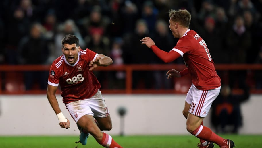 NOTTINGHAM, ENGLAND - JANUARY 07:  Eric Lichaj (L) of Nottingham Forest celebrates scoring his side's second goal during The Emirates FA Cup Third Round match between Nottingham Forest and Arsenal at City Ground on January 7, 2018 in Nottingham, England.  (Photo by Shaun Botterill/Getty Images)