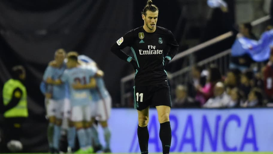 Real Madrid's Welsh forward Gareth Bale reacts after Celta Vigo's second goal during the Spanish league football match Celta de Vigo vs Real Madrid at the Balaidos stadium in Vigo on January 7, 2018. / AFP PHOTO / MIGUEL RIOPA        (Photo credit should read MIGUEL RIOPA/AFP/Getty Images)