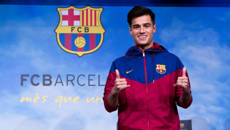 BARCELONA, SPAIN - JANUARY 07:  Philippe Coutinho poses prior to signing his new contract with FC Barcelona at Camp Nou on January 7, 2018 in Barcelona, Spain. The Brazilian player signed from Liverpool, has agreed a deal with the Catalan club until 2023 season.  (Photo by Alex Caparros/Getty Images)