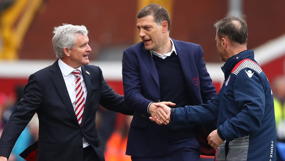 STOKE ON TRENT, ENGLAND - APRIL 29: Mark Hughes (L), Manager of Stoke City talks to Slaven Bilic, Manager of West Ham United after the Premier League match between Stoke City and West Ham United at Bet365 Stadium on April 29, 2017 in Stoke on Trent, England.  (Photo by Clive Brunskill/Getty Images)