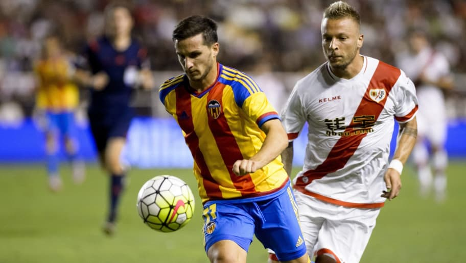 Valencia's Argentinian forward Pablo Piatti (L) vies with Rayo's German forward Patrick Ebert during the Spanish league football match Rayo Vallecano de Madrid vs Valencia CF at Vallecas stadium in Madrid, on August 22, 2015.   AFP PHOTO/ DANI POZO        (Photo credit should read DANI POZO/AFP/Getty Images)