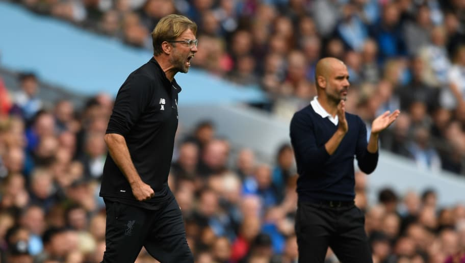 MANCHESTER, ENGLAND - SEPTEMBER 09:  Liverpool manager Jurgen Klopp (l) and Pep Guardiola react during the Premier League match between Manchester City and Liverpool at Etihad Stadium on September 9, 2017 in Manchester, England.  (Photo by Stu Forster/Getty Images)