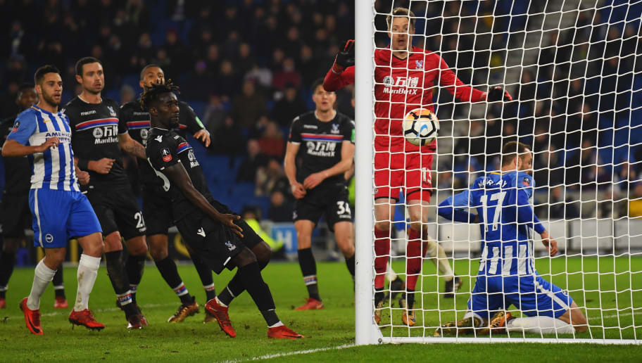 BRIGHTON, ENGLAND - JANUARY 08:  Glenn Murray of Brighton and Hove Albion (17) slides into the net  as he scores their second goal during The Emirates FA Cup Third Round match between Brighton & Hove Albion and Crystal Palace at Amex Stadium on January 8, 2018 in Brighton, England.  (Photo by Mike Hewitt/Getty Images)
