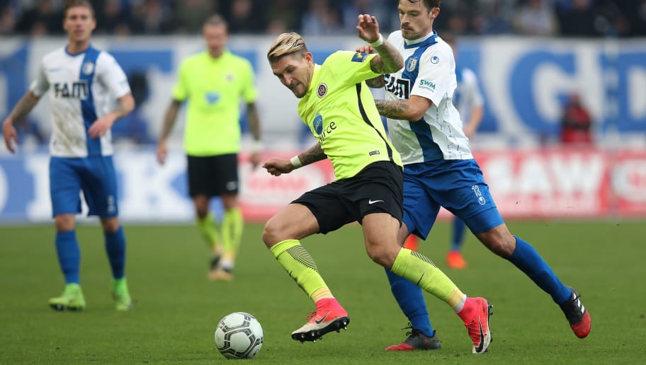 MAGDEBURG, GERMANY - NOVEMBER 04: Robert Andrich (L) of Wiesbaden and Dennis Erdmann (R) of Magdeburg vie during the 3. Liga match between 1. FC Magdeburg and SV Wehen Wiesbaden at MDCC-Arena on November 4, 2017 in Magdeburg, Germany. (Photo by Ronny Hartmann/Bongarts/Getty Images)