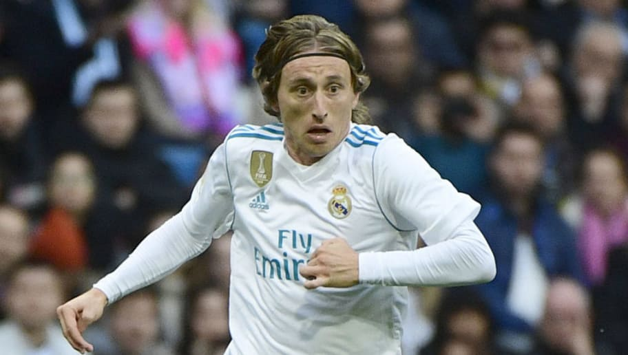 Real Madrid's Croatian midfielder Luka Modric controls the ball during the Spanish league football match between Real Madrid and Sevilla at the Santiago Bernabeu Stadium in Madrid on December 9, 2017. / AFP PHOTO / PIERRE-PHILIPPE MARCOU        (Photo credit should read PIERRE-PHILIPPE MARCOU/AFP/Getty Images)