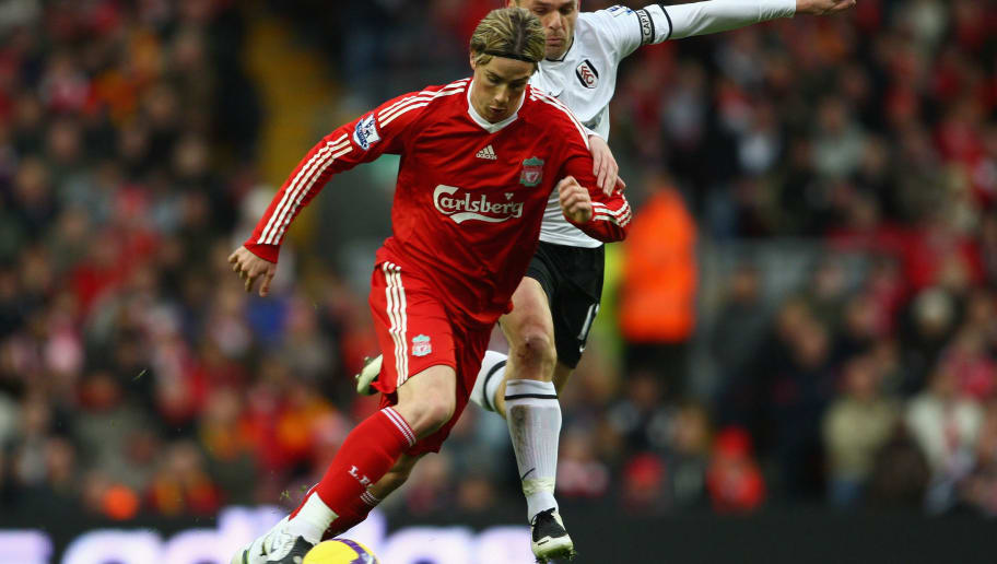 LIVERPOOL, UNITED KINGDOM - NOVEMBER 22:  Fernando Torres of Liverpool is challenged by Danny Murphy of Fulham during the Barclays Premier League match between Liverpool and Fulham at Anfield on November 22, 2008 in Liverpool, England.  (Photo by Clive Mason/Getty Images)