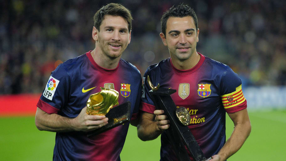 Barcelona's Argentinian forward Lionel Messi (L) holds the European Golden Boot 2012 award for best European goalscorer of the 2011-2012 season as his teammate midfielder Xavi Hernandez (R) holds the 2012 Prince of Asturias Prize for Sport before the Spanish league football match FC Barcelona vs Celta de Vigo at the Camp Nou stadium in Barcelona on November 3, 2012.    AFP PHOTO / JOSEP LAGO        (Photo credit should read JOSEP LAGO/AFP/Getty Images)