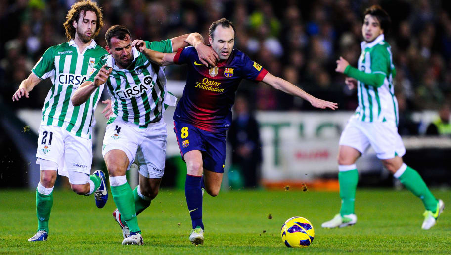 SEVILLE, SPAIN - DECEMBER 09:  Andres Iniesta of FC Barcelona duels for the ball with Antonio Amaya of Real Betis Balompie during the La Liga match between Real Betis Balompie and FC Barcelona at Estadio Benito Villamarin on December 9, 2012 in Seville, Spain.  (Photo by David Ramos/Getty Images)