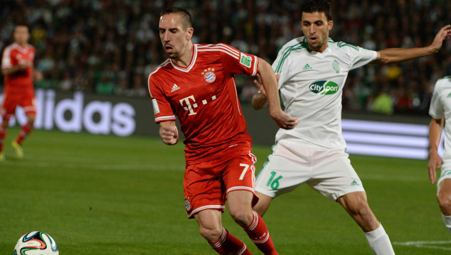 Bayern Munich's French midfielder Franck Ribery (L) dribbles past by Raja Casablanca's Morrocan defender Mohamed Oulhaj (R) during their 2013 FIFA Club World Cup final match in the Moroccan city of Marrakesh, on December 21, 2013. Bayern leads 2-0 at the end of the first half. AFP PHOTO / FADEL SENNA        (Photo credit should read FADEL SENNA/AFP/Getty Images)