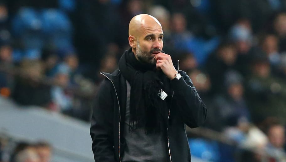 MANCHESTER, ENGLAND - JANUARY 09:  Josep Guardiola, Manager of Manchester City looks thoughtful during the Carabao Cup Semi-Final First Leg match between Manchester City and Bristol City at Etihad Stadium on January 9, 2018 in Manchester, England.  (Photo by Alex Livesey/Getty Images)