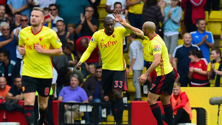 WATFORD, ENGLAND - AUGUST 12: Stefano Okaka of Watford celebrates scoring his sides first goal with Nordin Amrabat of Watford during the Premier League match between Watford and Liverpool at Vicarage Road on August 12, 2017 in Watford, England.  (Photo by Tony Marshall/Getty Images)