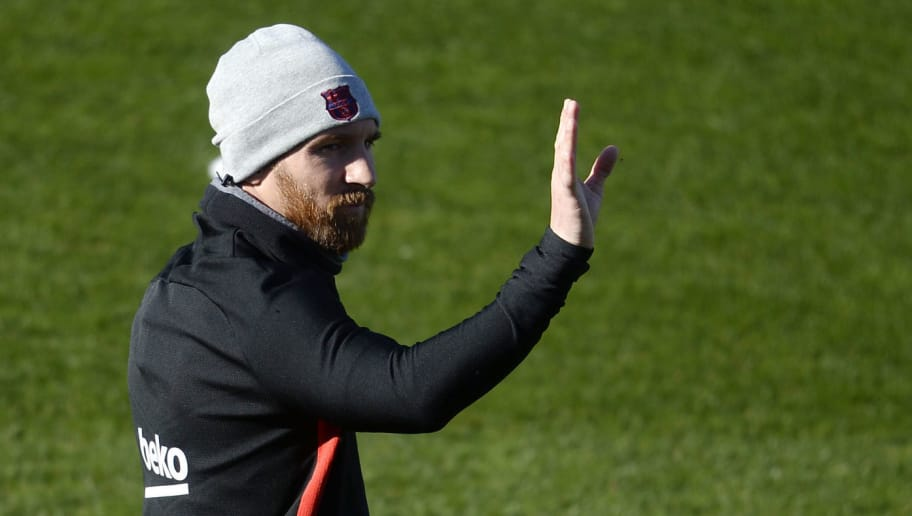 Barcelona's Argentinian forward Lionel Messi waves at supporters during a training session in Barcelona on January 5, 2018. / AFP PHOTO / Josep LAGO        (Photo credit should read JOSEP LAGO/AFP/Getty Images)