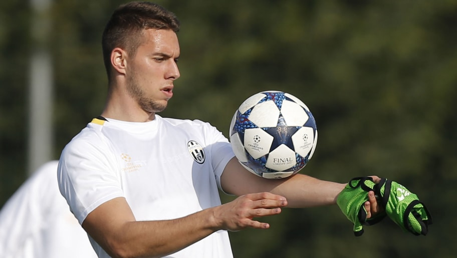 Juventus' midfielder Marko Pjaca from Croatia takes part in a training session on the eve of the UEFA Champions League football match Juventus Vs FC Porto on March 13, 2017 at the 'Juventus Training Center' in Vinovo, near Turin. / AFP PHOTO / Marco BERTORELLO        (Photo credit should read MARCO BERTORELLO/AFP/Getty Images)
