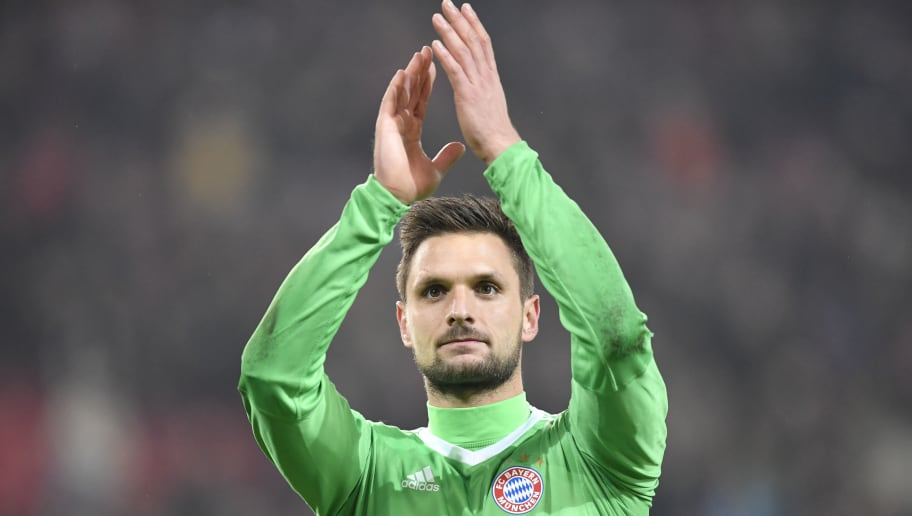 Munich's goalkeeper Sven Ulreich greets the fans after the German first division Bundesliga football match between VfB Stuttgart and Bayern Munich on December 16, 2017 in Stuttgart. / AFP PHOTO / THOMAS KIENZLE / RESTRICTIONS: DURING MATCH TIME: DFL RULES TO LIMIT THE ONLINE USAGE TO 15 PICTURES PER MATCH AND FORBID IMAGE SEQUENCES TO SIMULATE VIDEO. == RESTRICTED TO EDITORIAL USE == FOR FURTHER QUERIES PLEASE CONTACT DFL DIRECTLY AT + 49 69 650050         (Photo credit should read THOMAS KIENZLE/AFP/Getty Images)