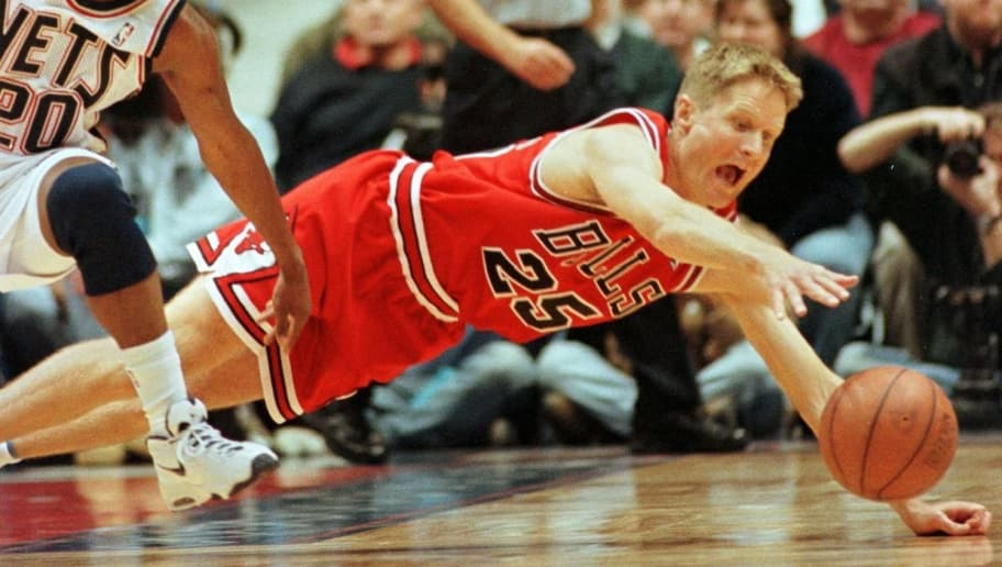 EAST RUTHERFORD, UNITED STATES:  Steve Kerr (R) of the Chicago Bulls dives for a loose ball in front of Sherman Douglas (L) of the New Jersey Nets during the second quarter of their game 20 December at the Continental Arena in East Rutherford, NJ. The Bulls won 100-92.  AFP PHOTO  Stan HONDA (Photo credit should read STAN HONDA/AFP/Getty Images)
