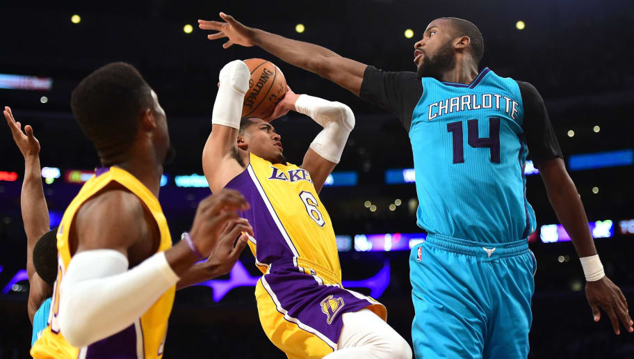 LOS ANGELES, CA - FEBRUARY 28:  Jordan Clarkson #6 of the Los Angeles Lakers attempts a shot over the hands of Michael Kidd-Gilchrist #14 of the Charlotte Hornets during a 109-104 Hornet win at Staples Center on February 28, 2017 in Los Angeles, California.  NOTE TO USER: User expressly acknowledges and agrees that, by downloading and or using this photograph, User is consenting to the terms and conditions of the Getty Images License Agreement.  (Photo by Harry How/Getty Images)