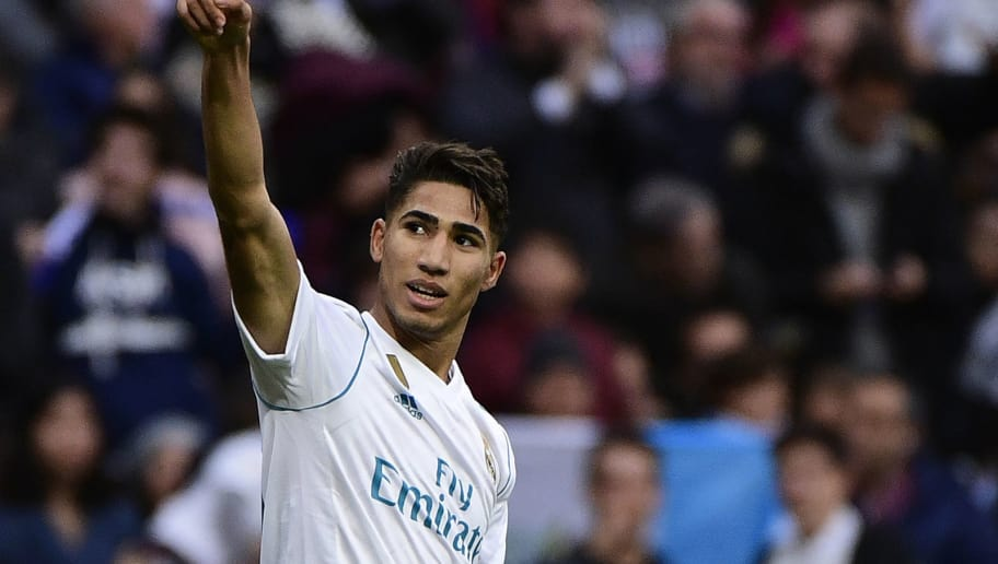 Real Madrid's Spanish-Moroccan defender Achraf Hakimi celebrates after scoring his team's fifth goal during the Spanish league football match between Real Madrid and Sevilla at the Santiago Bernabeu Stadium in Madrid on December 9, 2017. / AFP PHOTO / PIERRE-PHILIPPE MARCOU        (Photo credit should read PIERRE-PHILIPPE MARCOU/AFP/Getty Images)